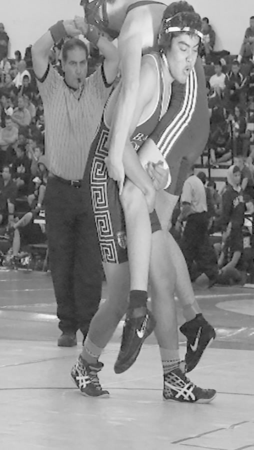 Moises Cortez lifting his opponent.