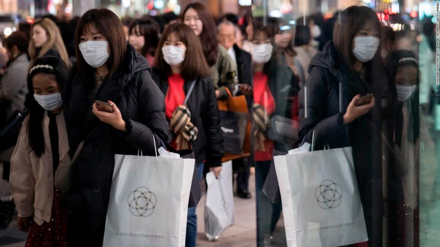 TOKYO, JAPAN - JANUARY 24: People wearing masks walk through the Ginza shopping district on January 24, 2020 in Tokyo, Japan. While Japan is one of the most popular foreign travel destinations for Chinese tourists during the Lunar New Year holiday this year, Japan reported two cases of Wuhan coronavirus infections as the number of those who have died from the virus in China climbed to 25 on Friday and cases have been reported in other countries including the United States, Thailand, Taiwan, Vietnam, Singapore and South Korea. (Photo by Tomohiro Ohsumi/Getty Images)